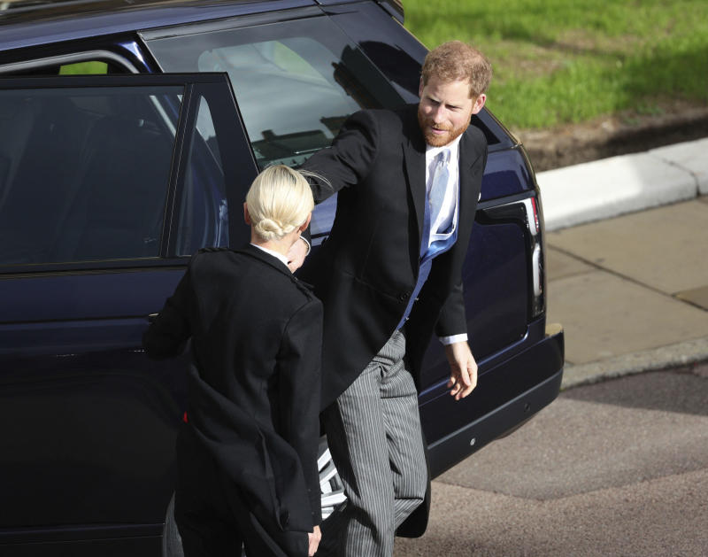 Prince Harry arrives for the wedding.