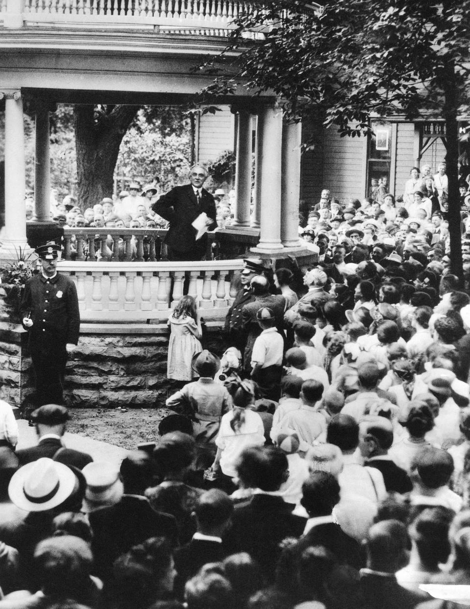 FILE-This July 1920 file photo shows six thousand people gathering to hear Sen. Warren G. Harding, R-OH, speak from the porch of his home in Marion, Ohio. The centennial of President Warren G. Harding's election was marked Monday in his home county in Ohio with a modest radio tribute rather than the grand museum and homestead re-opening envisioned before the pandemic. Harding, a Republican, was elected Nov. 2, 1920, his 55th birthday, succeeding Democrat Woodrow Wilson. He beat a fellow Ohio newspaper publisher, James Cox, on a platform of restoring normalcy after World War I and the 1918 influenza pandemic. (AP Photo, File)