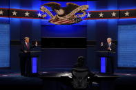FILE - President Donald Trump, left, and Democratic presidential candidate former Vice President Joe Biden during the second and final presidential debate at Belmont University in Nashville, Tenn. on Oct. 22, 2020. Television networks are adding experts in election law to their election night coverage teams so they're prepared to explain legal challenges or irregularities that come up during the vote. (AP Photo/Patrick Semansky, File)