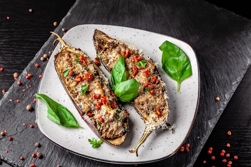 Portuguese cuisine. Baked eggplants with mushrooms, meat, vegetables and parmesan cheese. Copy space, selective focus (Photo: Zufar Kamilov via Getty Images)