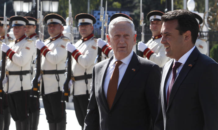 U.S. Defense Secretary James Mattis, center, accompanied by Macedonian Prime Minister Zoran Zaev, right, walks past an honor guard squad upon his arrival at the government building in Skopje, Macedonia, Monday, Sept. 17, 2018. UMattis arrived in Macedonia Monday, condemning Russian efforts to use its money and influence to build opposition to an upcoming vote that could pave the way for the country to join NATO, a move Moscow opposes. (AP Photo/Boris Grdanoski)
