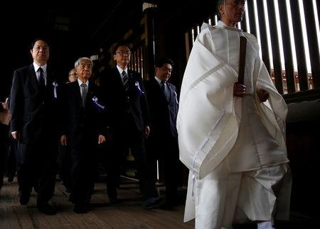 A group of lawmakers including Japan's ruling Liberal Democratic Party (LDP) lawmaker Hidehisa Otsuji (2nd L) are led by a Shinto priest as they visit Yasukuni Shrine in Tokyo, Japan April 21, 2017.  REUTERS/Toru Hanai