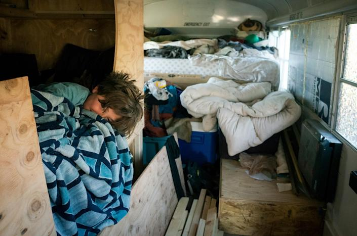 """Max snuggles inside his bed in the back of the bus while Paula makes breakfast on Feb. 20.<span class=""""copyright"""">Nina Riggio for TIME</span>"""