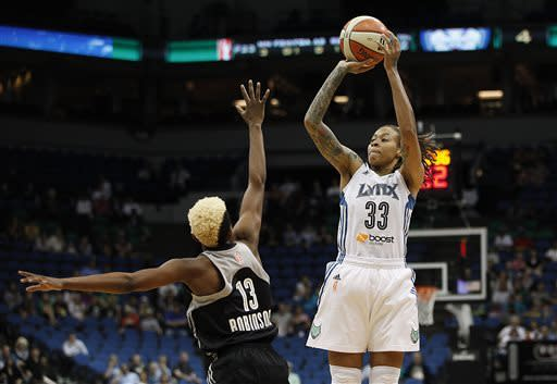 Minnesota Lynx guard Seimone Augustus (33) takes a shot against San Antonio Silver Stars guard Danielle Robinson (13) in the first half of a WNBA basketball game, Tuesday, June 11, 2013, in Minneapolis. (AP Photo/Stacy Bengs)