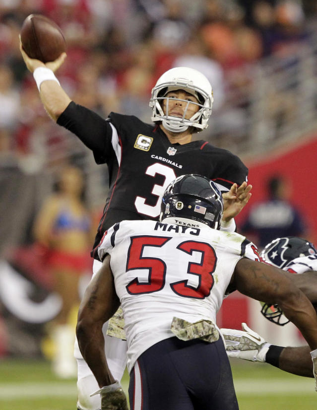 Arizona Cardinals quarterback Carson Palmer (3) throws under pressure from Houston Texans inside linebacker Joe Mays (53) during the second half of an NFL football game Sunday, Nov. 10, 2013, in Glendale, Ariz. (AP Photo/Rick Scuteri)
