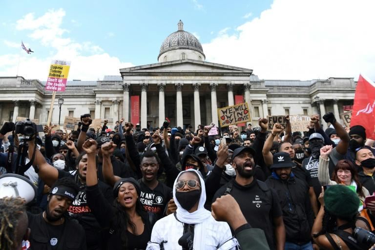 A march by several hundred Black Lives Matter activists through the British capital went ahead at lunchtime Saturday, ending in Trafalgar Square near where counter protesters had gathered and amid a heavy police presence (AFP Photo/DANIEL LEAL-OLIVAS)