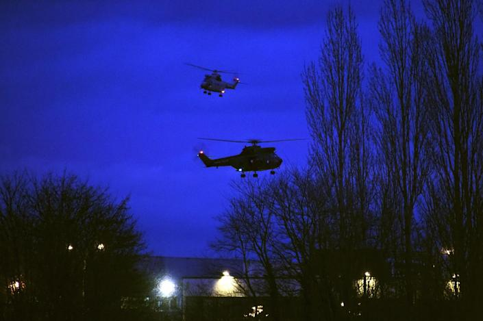 Helicopters fly over buildings in Dammartin-en-Goele, north-east of Paris, after two brothers suspected of slaughtering 12 people in an Islamist attack on French satirical newspaper Charlie Hebdo were shot dead by police, on January 9, 2015 (AFP Photo/Dominique Faget)