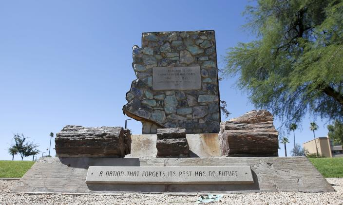 FILE - In this June 8, 2020, file photo, is a monument to the region's Confederate troops at a public plaza adjacent to the state Capitol in Phoenix. Republicans in the Arizona Legislature are reacting to last year's wave of damage to Confederate monuments by civil rights protesters here and across the nation by working to make it a felony to damage or destroy any public or private monument or statue. (AP Photo/Ross D. Franklin, File)
