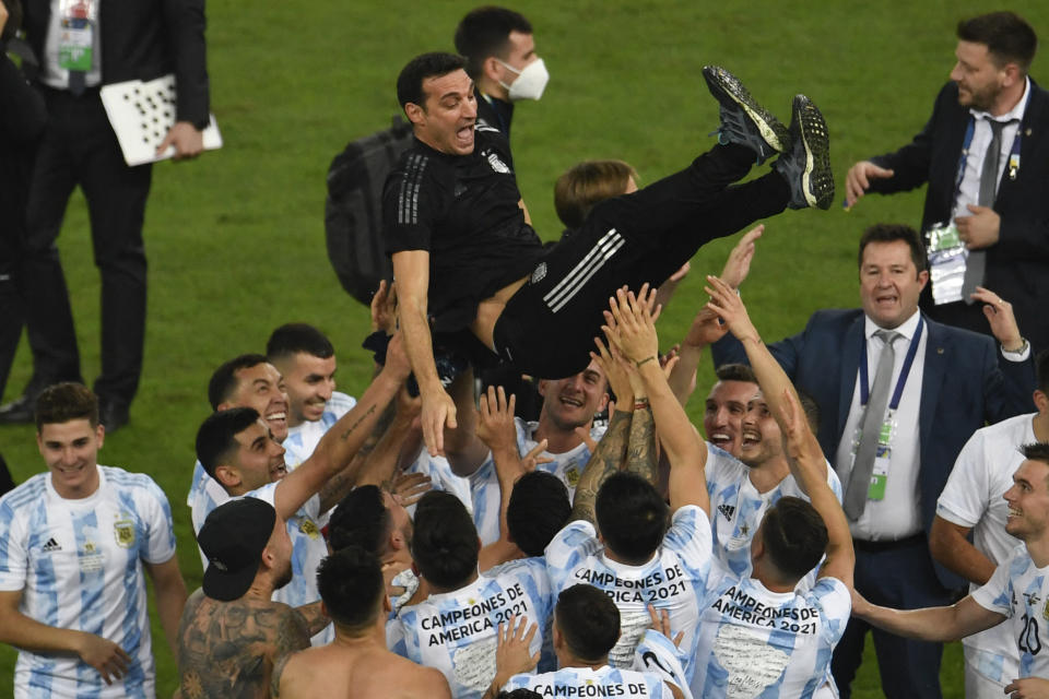 Players of Argentina celebrate by throwing Argentina's coach Lionel Scaloni into the air after winning the Conmebol 2021 Copa America football tournament final match against Brazil at Maracana Stadium in Rio de Janeiro, Brazil, on July 10, 2021. (Photo by MAURO PIMENTEL / AFP) (Photo by MAURO PIMENTEL/AFP via Getty Images)