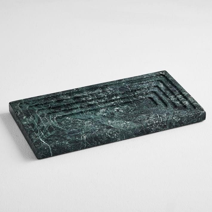 <p>You can keep everything organized with these <span>West Elm Stepped Marble Vanity Trays</span> ($32, originally $35).</p>