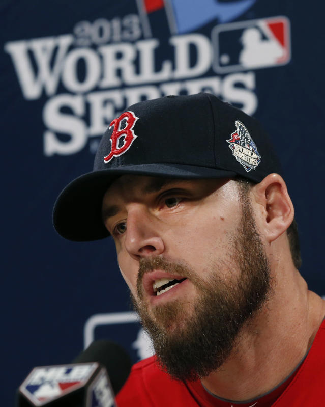 Boston Red Sox pitcher John Lackey speaks during a news conference prior to a workout at Fenway Park in Boston, Tuesday, Oct. 29, 2013. Lackey is scheduled to start Game 6 of baseball's World Series against the St. Louis Cardinals on Wednesday in Boston. (AP Photo/Elise Amendola)