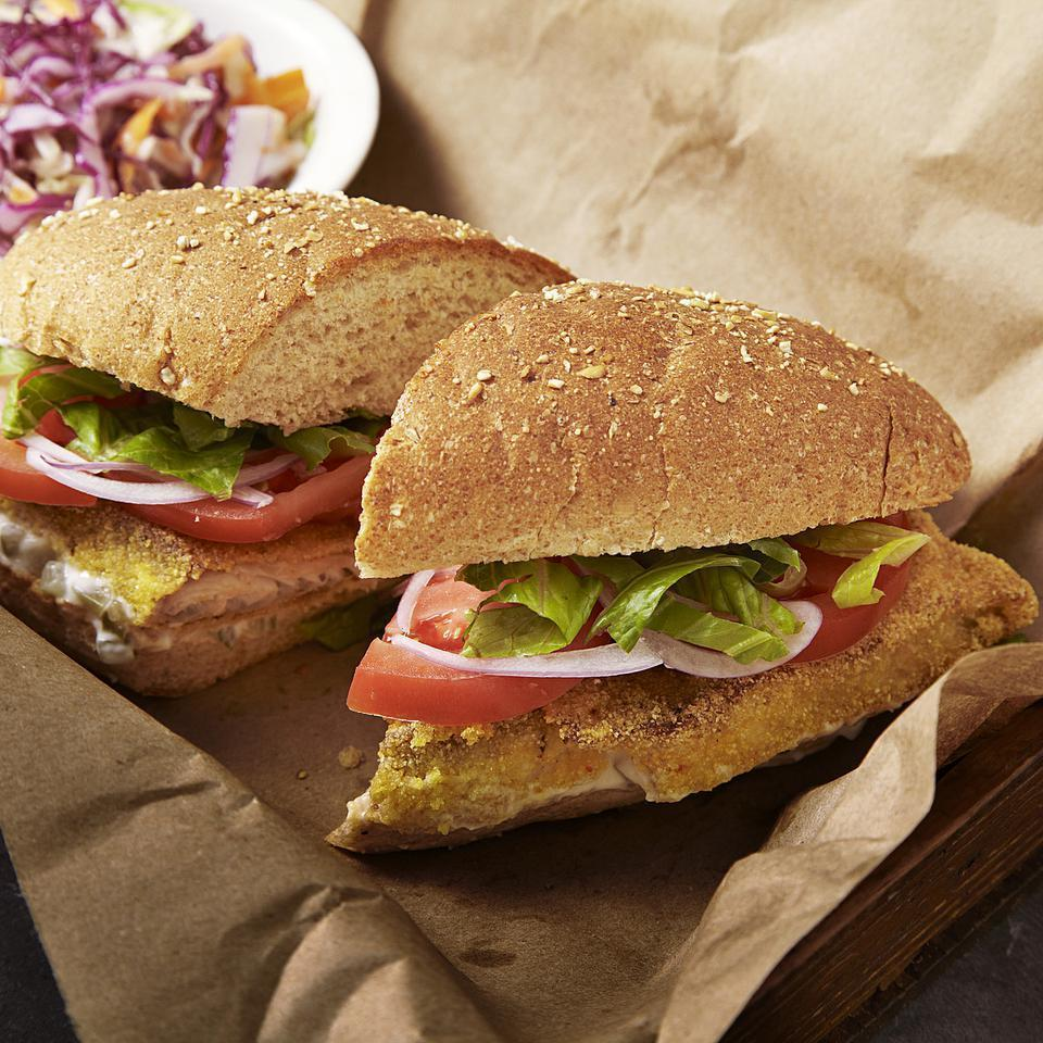 <p>Forget deep-fried fish--the tilapia in this healthy po'boy recipe, a classic Cajun sandwich recipe, is coated in cornmeal and cooked in just 2 tablespoons of oil. The result? A healthy, crispy fish sandwich without extra calories. Serve with coleslaw and sweet potato fries.</p>