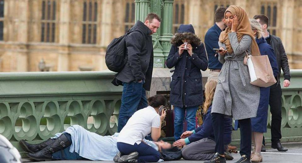 Man who posted image of Muslim woman 'ignoring Westminster terror victims' was a Russian troll