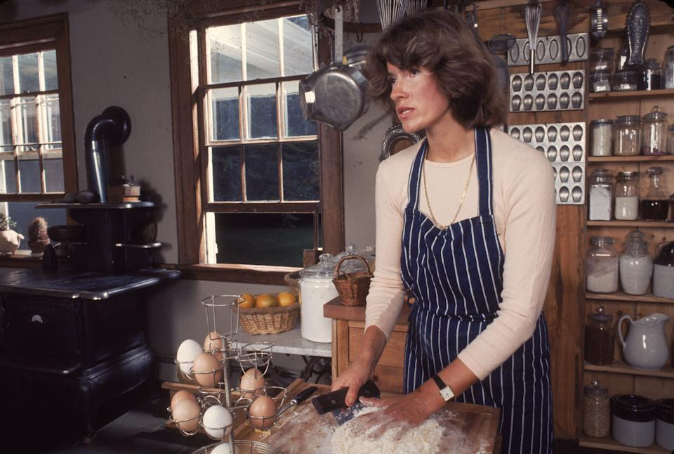 Stewart kneads flour in August 1976.