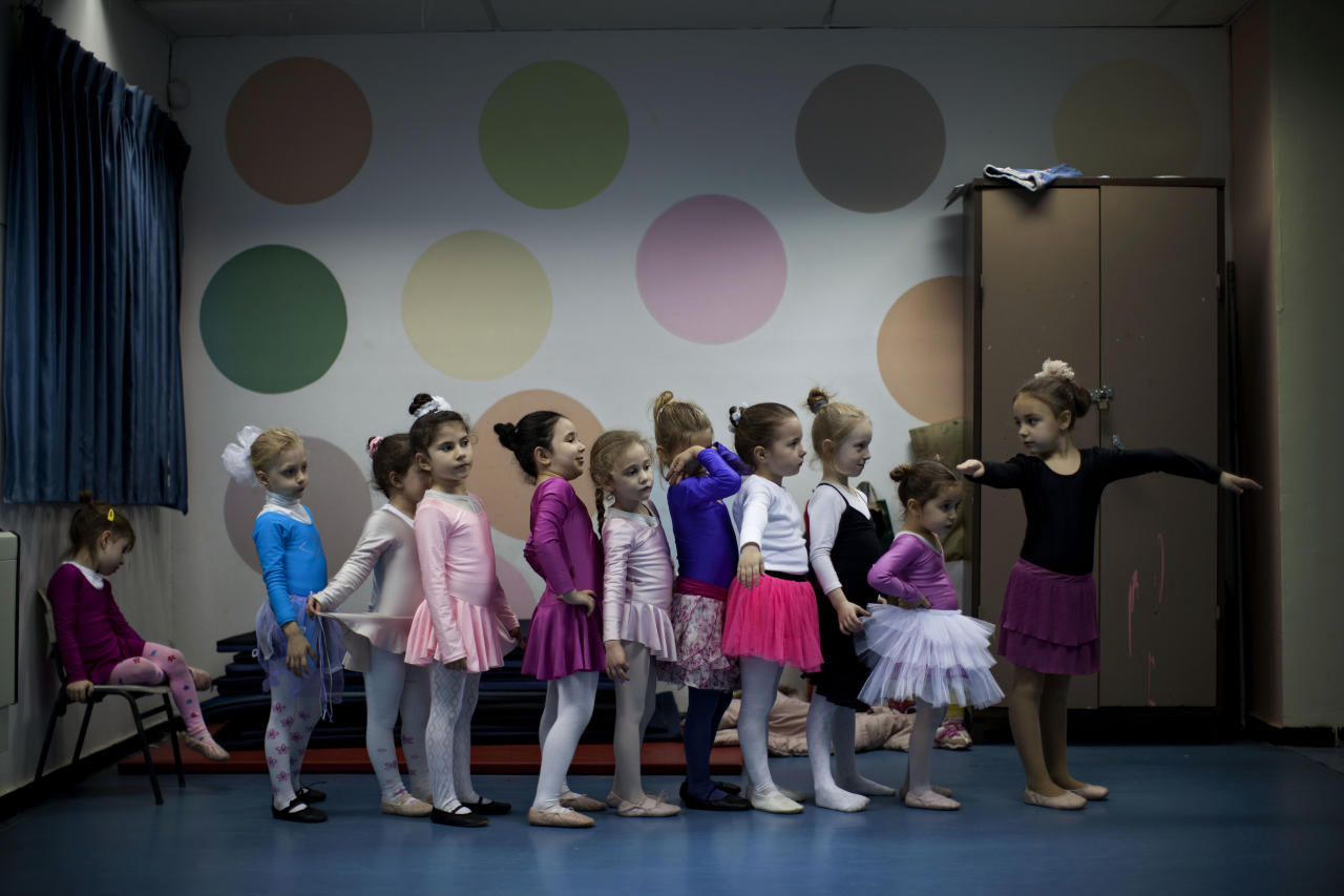 In this Jan. 31, 2012 photo, the children of immigrants from the former Soviet Union attend a ballet class in Lod, central Israel. Some prominent ballet dancers left the former Soviet Union for Israel, forming ballet schools and continuing a dance culture highly regarded in their countries of origin. (AP Photo/Oded Balilty)