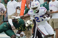 Florida running back Dameon Pierce (21) gets past South Florida safety Vincent Davis on a run during the first half of an NCAA college football game Saturday, Sept. 11, 2021, in Tampa, Fla. (AP Photo/Chris O'Meara)