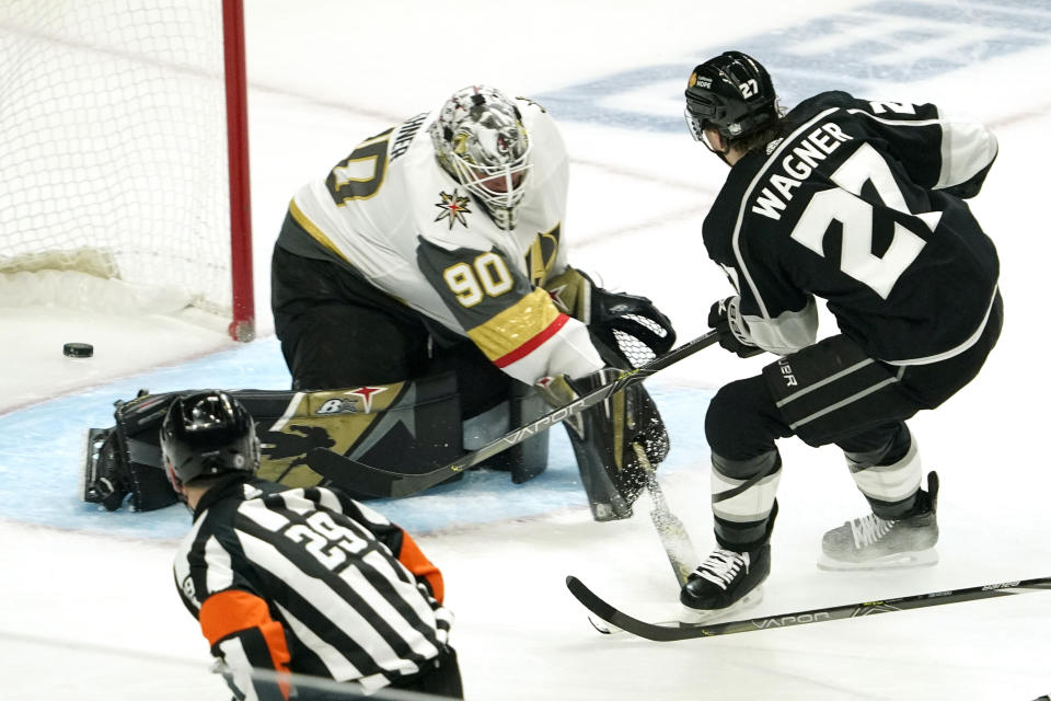 Los Angeles Kings left wing Austin Wagner, right, scores on Vegas Golden Knights goaltender Robin Lehner during the first period of an NHL hockey game Monday, April 12, 2021, in Los Angeles. (AP Photo/Mark J. Terrill)