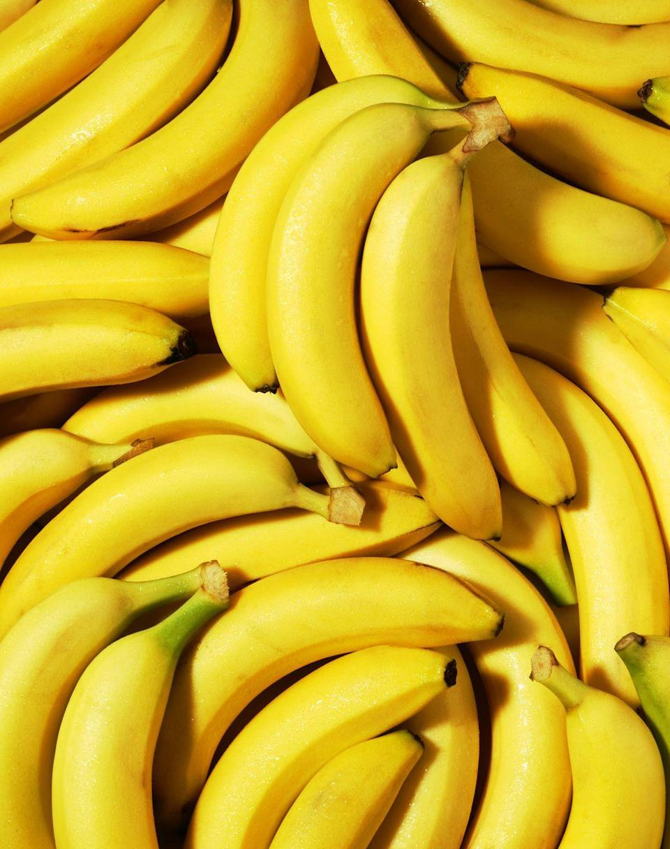 """<p>Rich in soluble fiber, <a href=""""https://www.goodhousekeeping.com/health/diet-nutrition/a47807/banana-nutrition/"""" rel=""""nofollow noopener"""" target=""""_blank"""" data-ylk=""""slk:bananas"""" class=""""link rapid-noclick-resp"""">bananas</a> are an easy grab-and-go snack that can help lower cholesterol. For an extra heart-healthy boost, slice bananas on top of morning oats with a tablespoon of chia seeds and walnuts. It's a hearty, energy-packed <a href=""""https://www.goodhousekeeping.com/food-recipes/easy/g871/quick-breakfasts/"""" rel=""""nofollow noopener"""" target=""""_blank"""" data-ylk=""""slk:breakfast"""" class=""""link rapid-noclick-resp"""">breakfast</a> loaded with fiber, vitamin B6, potassium, magnesium, vitamin C and manganese.</p><p><strong>RELATED: </strong><a href=""""https://www.goodhousekeeping.com/health/diet-nutrition/g5047/cheap-healthy-foods/"""" rel=""""nofollow noopener"""" target=""""_blank"""" data-ylk=""""slk:25 Cheap Healthy Foods You Can Buy at the Grocery Store"""" class=""""link rapid-noclick-resp"""">25 Cheap Healthy Foods You Can Buy at the Grocery Store</a></p>"""
