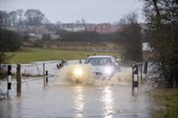 Cars pass through a flood along Hamilton Road in Leicester, as heavy snow and freezing rain is set to batter the UK this week, with warnings issued over potential power cuts and travel delays. (Photo by Joe Giddens/PA Images via Getty Images)