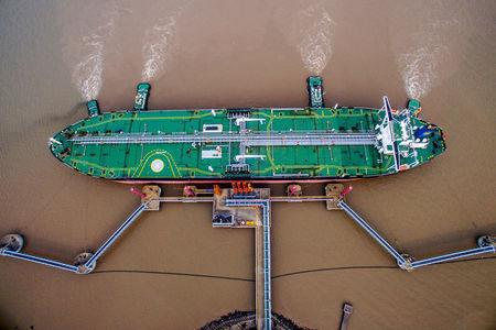 FILE PHOTO: Oil tanker unloads crude at a terminal in Zhoushan
