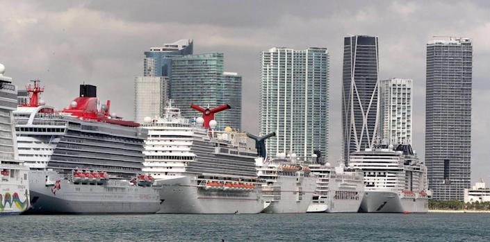 Cruise ships line up at PortMiami on Tuesday, March 17, 2020, amid the COVID-19 pandemic.