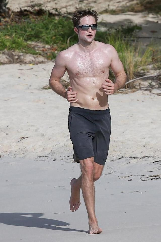 <p>The <em>Twilight</em> star may be on vacation in Antigua, but he's not taking a break from his workout routine. The actor went for a (shirtless!) jog on the beach on Monday at Half Moon Bay, where he's spending some downtime for the week. (Photo: Backgrid) </p>