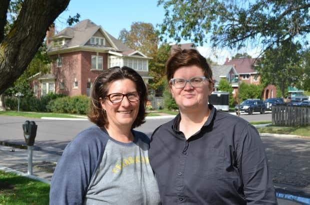 Christy Tashjian, left, and her wife Jenni Huntly moved from Texas to Thunder Bay when Huntly received a job in the northwestern Ontario city. Tashjian, a nurse practitioner in the U.S., thought it would be easy to become registered in Ontario. But more than 20 months later, she's still waiting to work. (Logan Turner / CBC - image credit)