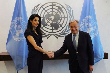 International human rights lawyer Amal Clooney shakes hands with United Nations Secretary General, Antonio Guterres, at U.N. headquarters in New York, U.S., March 10, 2017.  REUTERS/Lucas Jackson