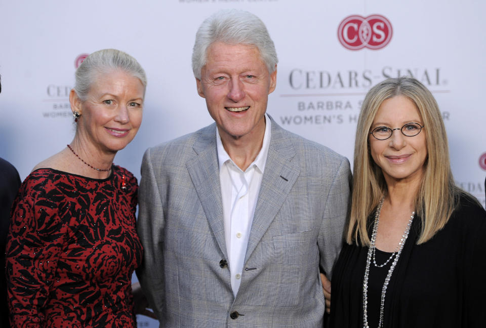 Former President Bill Clinton, center, poses with Barbra Streisand, right, and cardiologist C. Noel Bairey Merz, MD, at the dedication of the Barbra Streisand Women's Heart Center in the Cedars-Sinai Heart Institute, on Thursday June 14, 2012 at Streisand's home in Malibu, Calif. Merz will be the director of the center. (Photo by Chris Pizzello/Invision/AP)