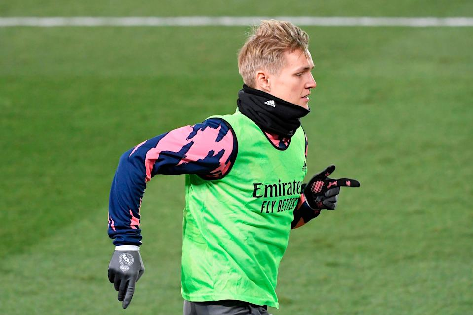 <p>Arsenal are optimistic over signing Martin Odegaard from Real Madrid</p> (AFP via Getty Images)