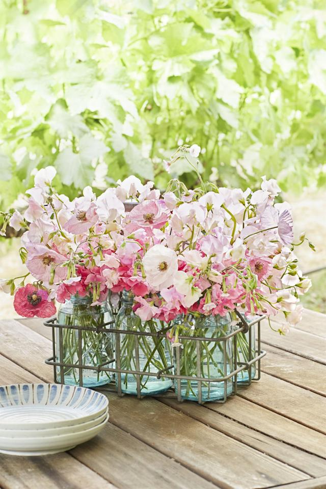 <p>Featurecolorful mason jars in a metal milk carrier for an easy, beautifulcenterpiece.<span></span></p>