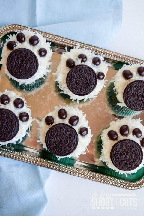 """<p>These incredibly cute cupcakes are also incredibly easy to decorate.</p><p><strong><a href=""""http://afewshortcuts.com/2015/12/polar-bear-paw-cupcakes-recipe-normofthenorth/"""" rel=""""nofollow noopener"""" target=""""_blank"""" data-ylk=""""slk:Get the recipe at A Few Short Cuts."""" class=""""link rapid-noclick-resp"""">Get the recipe at A Few Short Cuts.</a></strong></p>"""