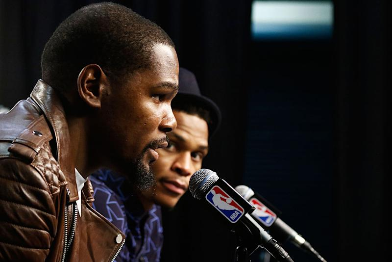 Russell Westbrook (right) listens to Kevin Durant after the Thunder beat the Warriors in Game 4 of the 2016 Western Conference Finals. (J Pat Carter/Getty Images)