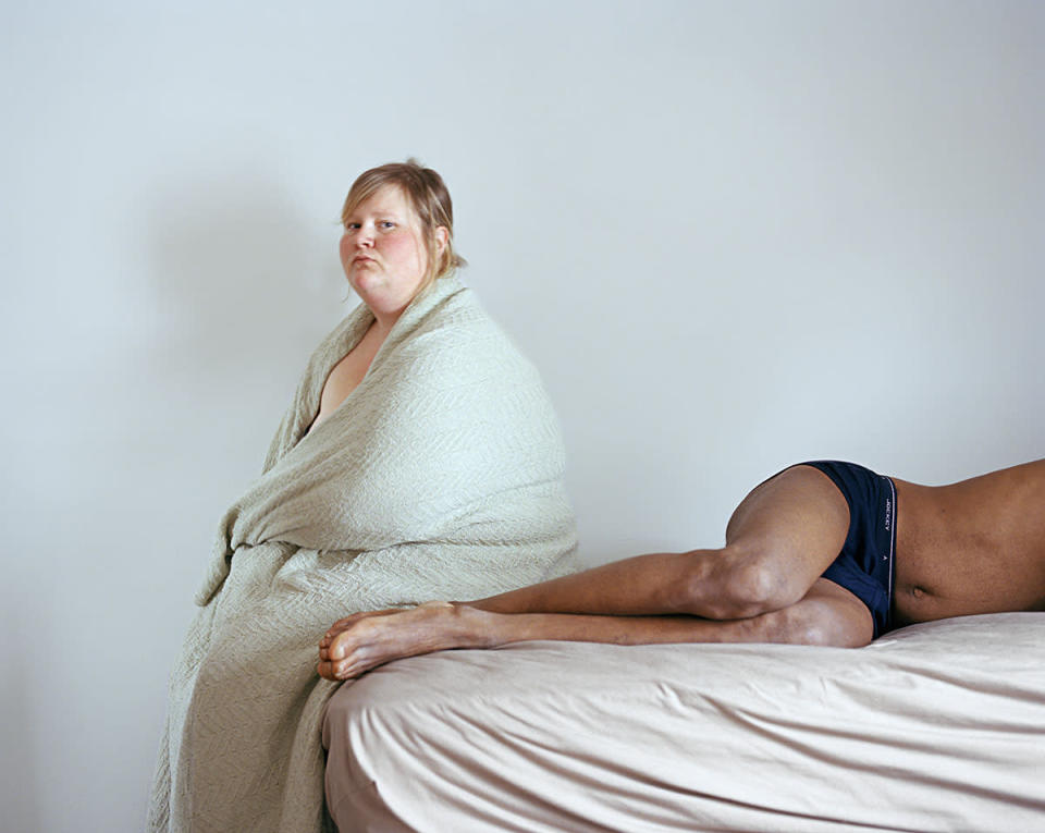 """<div class=""""caption-credit""""> Photo by: Jen Davis Photo</div>Steve and I: """"This represents post-intimacy, a time when you're supposed to feel relaxed and happy. But the expression on my face and the blanket I'm wrapped in expresses my discomfort,"""" says <a rel=""""nofollow noopener"""" href=""""http://jendavisphoto.com/"""" target=""""_blank"""" data-ylk=""""slk:Davis"""" class=""""link rapid-noclick-resp"""">Davis</a>."""