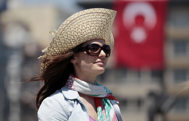 A protester stands in a silent protest at Taksim Square in, Istanbul, Turkey, Tuesday, June 18, 2013. After weeks of sometimes-violent confrontation with police, Turkish protesters have found a new form of resistance: standing still and silent. (AP Photo/Petr David Josek)