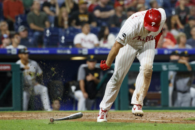Philadelphia Phillies' J.T. Realmuto slams his bat after flying out against Pittsburgh Pirates relief pitcher Felipe Vazquez during the ninth inning of a baseball game Tuesday, Aug. 27, 2019, in Philadelphia. Pittsburgh won 5-4. (AP Photo/Matt Slocum)