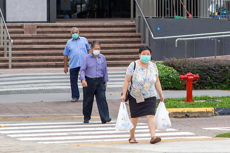 People seen in face masks outside the Great World City shopping mall on 5 May 2020. (PHOTO: Dhany Osman / Yahoo News Singapore)