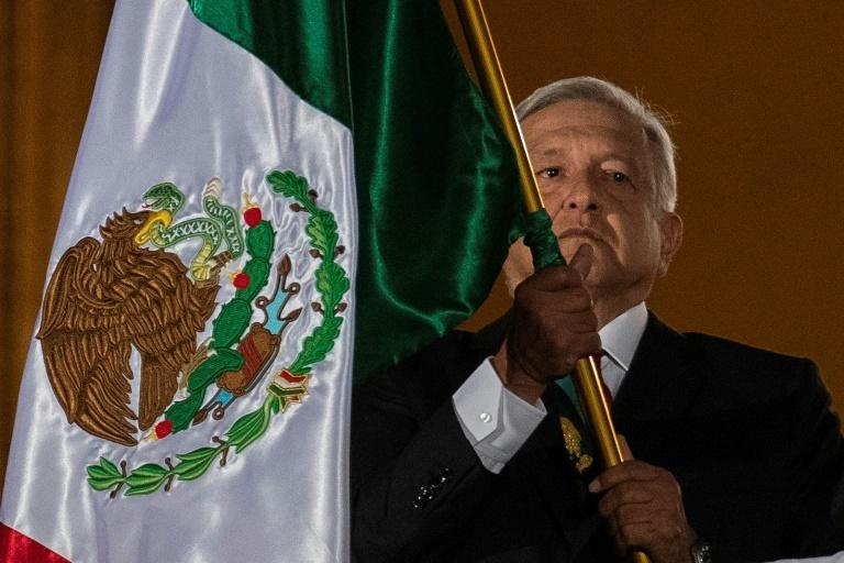 Mexican President Andres Manuel Lopez Obrador waves a Mexican flag at Independence Day celebrations in Mexico City on September 15, 2019