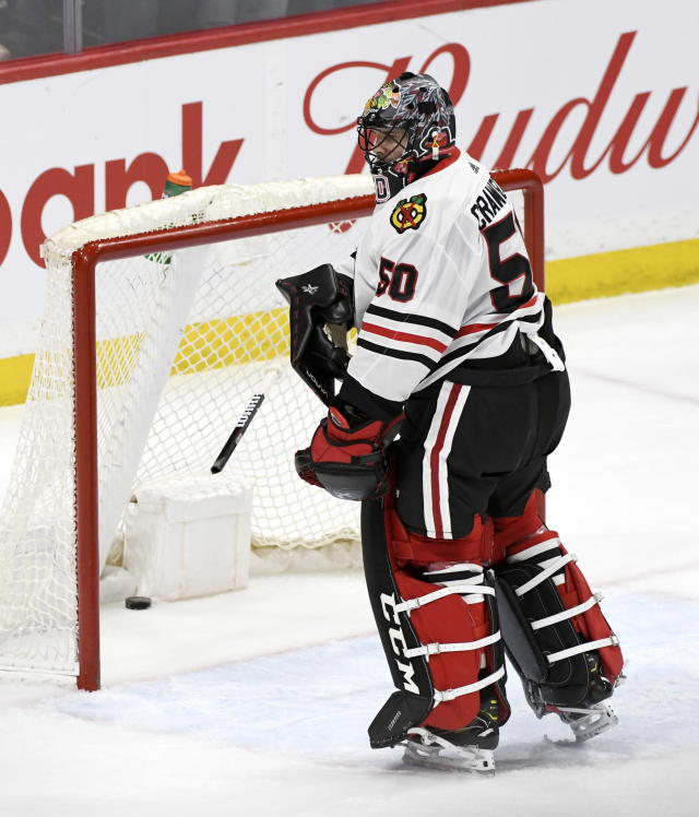 Chicago Blackhawks goaltender Corey Crawford (50) throws the end of his stick after breaking it on the net after conceding the game-winning goal against the Winnipeg Jets during third period NHL hockey action in Winnipeg, Manitoba on Sunday, Feb. 9, 2020. (Fred Greenslade/The Canadian Press via AP)
