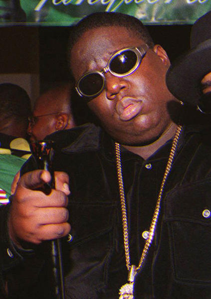**FILE**In this March 8, 1997 file photo, Notorious B.I.G., whose real name is Christopher Wallace gestures shortly before he was shot to death. Authorities have unsealed an autopsy report the week of Nov. 26, 2012 showing that rapper Notorious B.I.G. was shot four times in a 1997 drive-by shooting that remains unsolved. (AP Photo/Venus Bernardo-Prudhomme, File) ** MANDATORY CREDIT NO SALES **