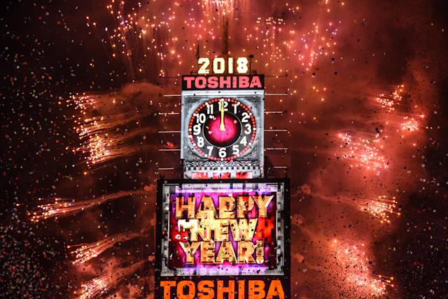 <p>Fireworks explode in Times Square on New Year's Eve on January 1, 2018 in New York City. (Photo: Stephanie Keith/Getty Images) </p>