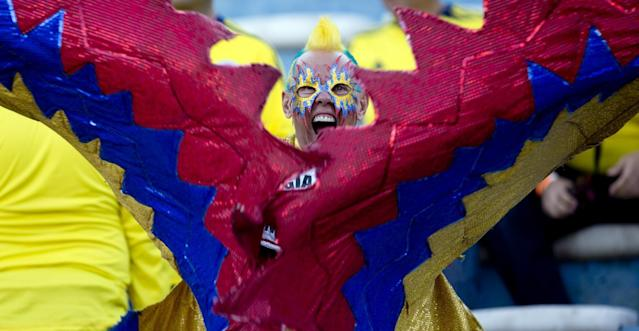 A Colombia soccer fan gets revved up before the start of a 2014 World Cup qualifying soccer match against Uruguay in Montevideo, Uruguay, Tuesday, Sept. 10, 2013. (AP Photo/Natacha Pisarenko)