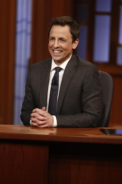 "In this photo provided by NBC, host Seth Meyers smiles during the premiere of ""Late Night with Seth Meyers"" on Monday, Feb. 24, 2014, in New York. (AP Photo/NBC, Peter Kramer)"