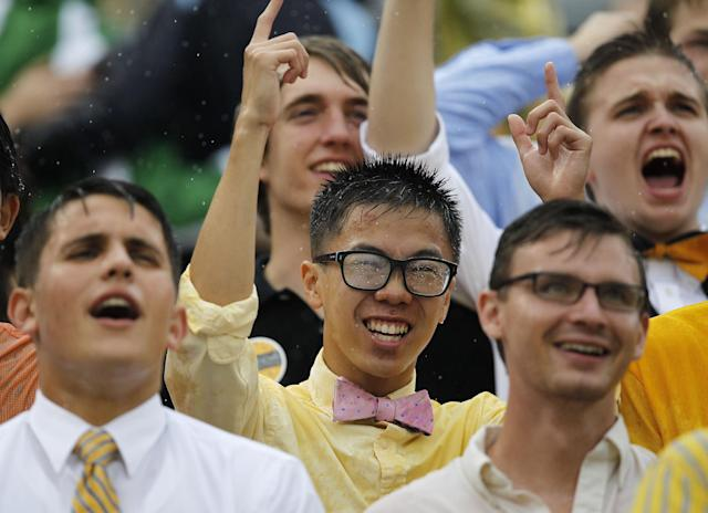 Georgia Tech fans cheer in the rain during the first half of an NCAA football game against the North Carolina, Saturday, Sept. 21, 2013, in Atlanta. (AP Photo/Mike Stewart)