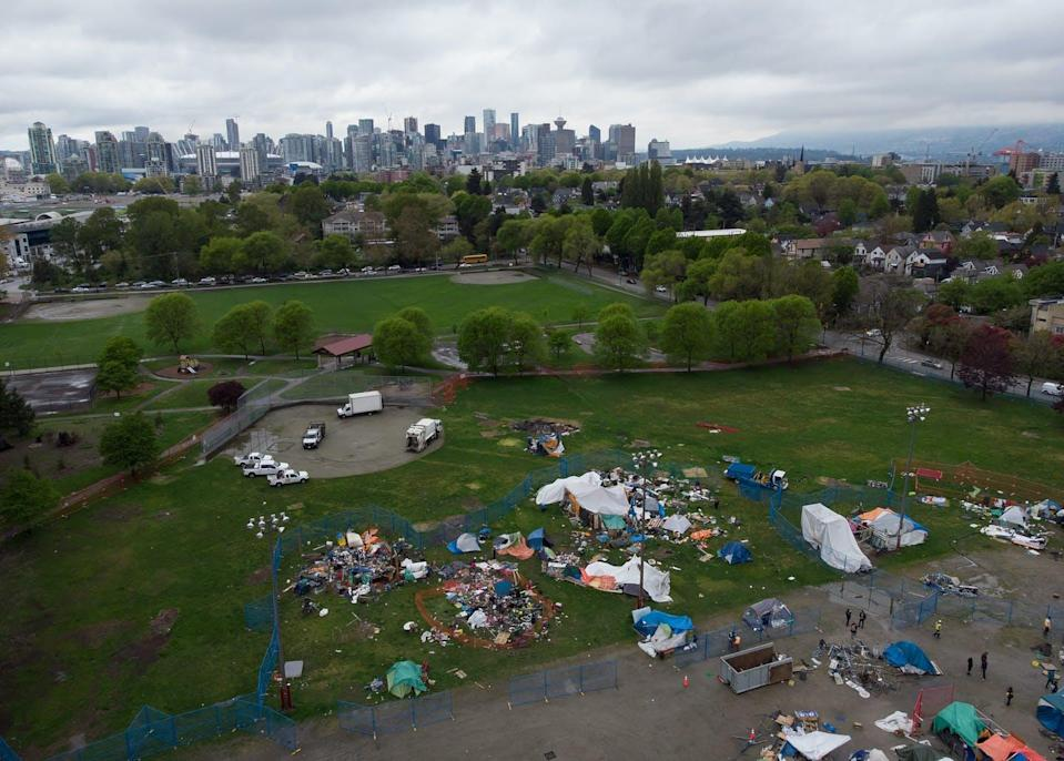 Drone shot of tent camp in park in Vancouver's Strathcona Park. Tents amid baseball field