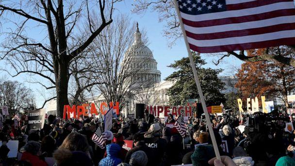 PHOTO: Protesters supporting the impeachment of U.S. President Donald Trump gather outside the U.S. Capitol Dec. 18, 2019, in Washington. (Win Mcnamee/Getty Images)