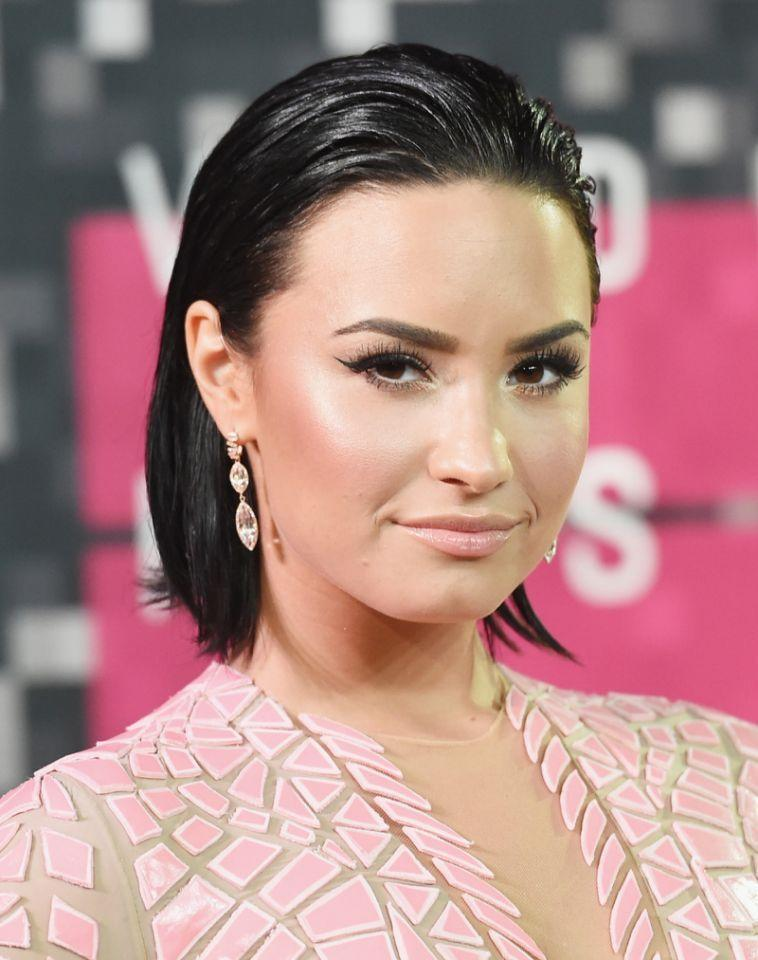 <p>Lovato looked cool and confident with her slicked back bob at the VMAs. <i>(Photo: Getty Images)</i></p>
