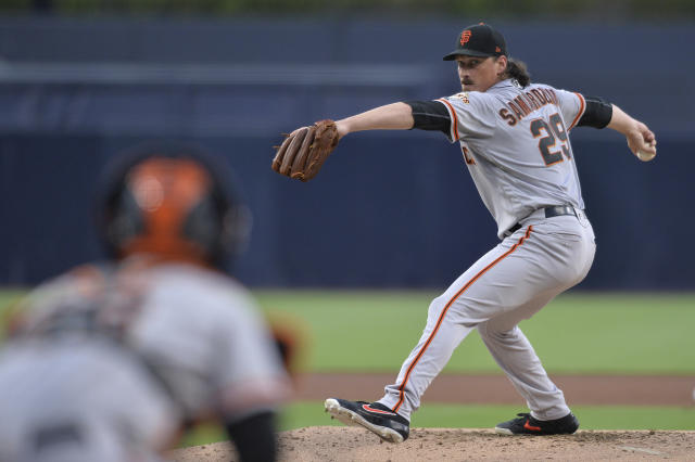 San Francisco Giants starting pitcher Jeff Samardzija, right, works against a San Diego Padres batter during the first inning of a baseball game Friday, July 26, 2019, in San Diego. (AP Photo/Orlando Ramirez)