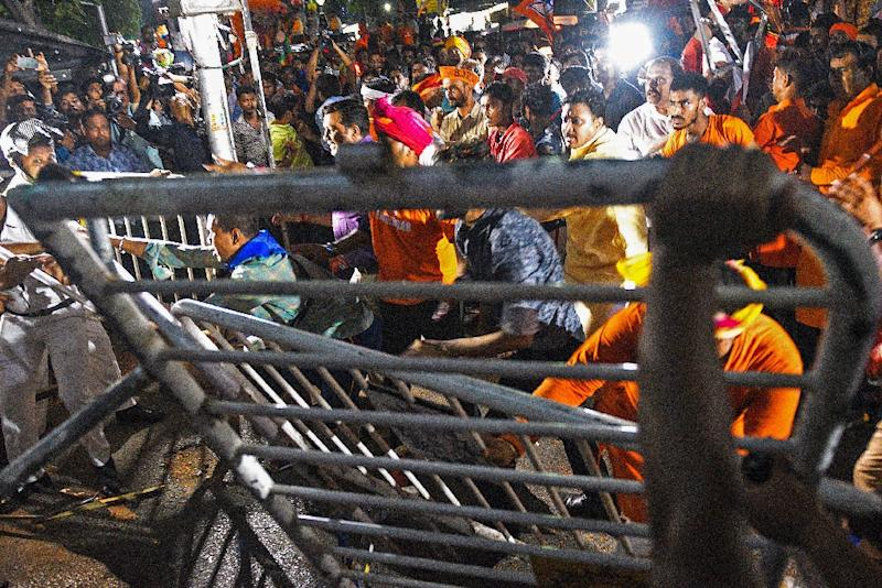 More than a hundred people were arrested in street battles that forced Amit Shah to leave an election rally under armed guard (AFP Photo/STR)