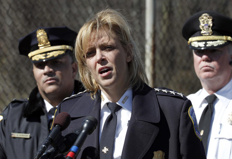 Washington Metro Police Chief Cathy Lanier, center, speaks during a media availability about a body found in Kenilworth Park in Washington, Monday, March 31, 2014. Police have been searching the park in northeast Washington since last week for clues in the case of eight-year-old Relisha Rudd, last seen in the company of Kahlil Tatum, a janitor at the homeless shelter where she lived with her mother and brothers.(AP Photo/Alex Brandon)